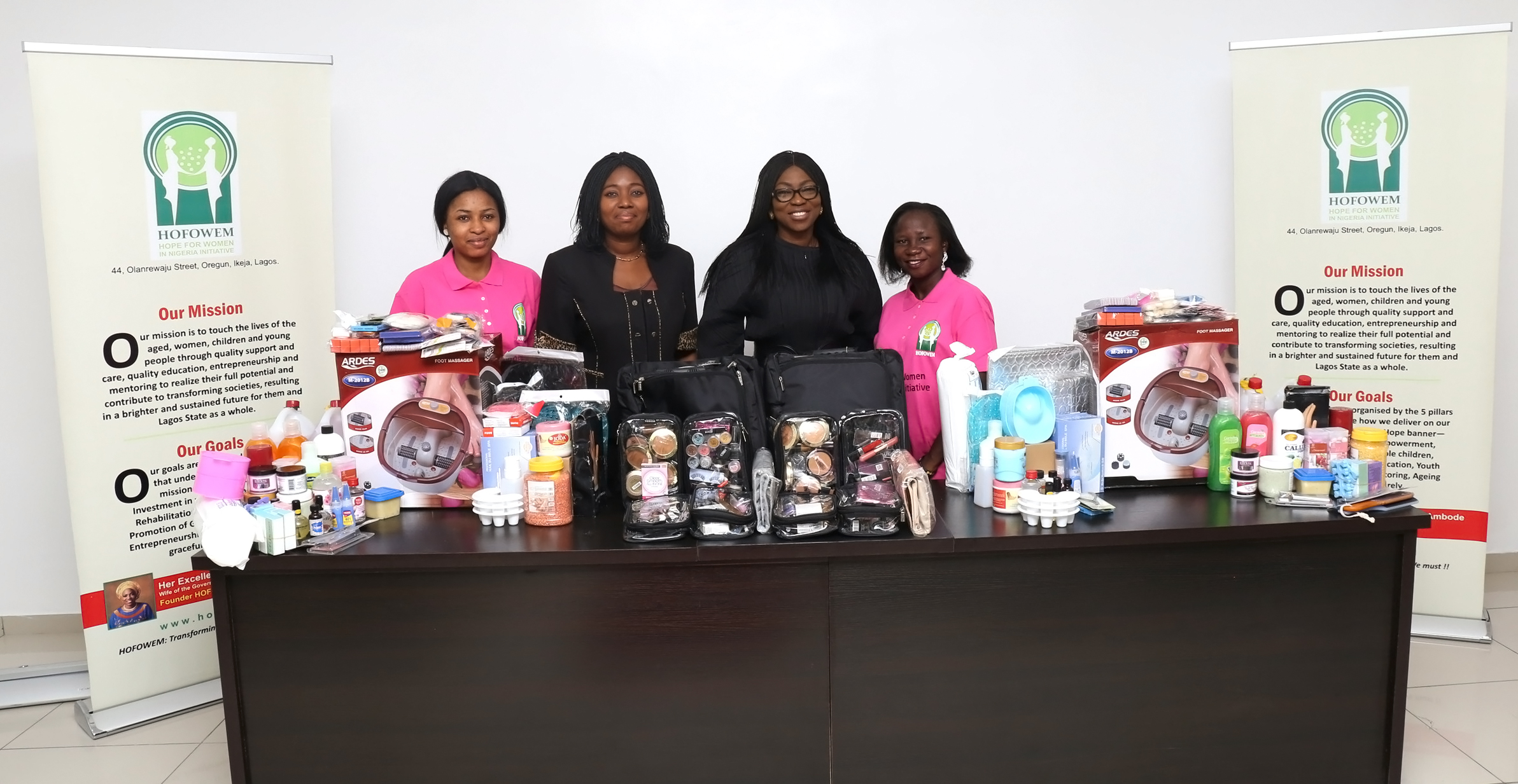 Our Founder flanked by HOFOWEM CEO Mrs. Oyefunke Olayinka during the presentation of the work kits.