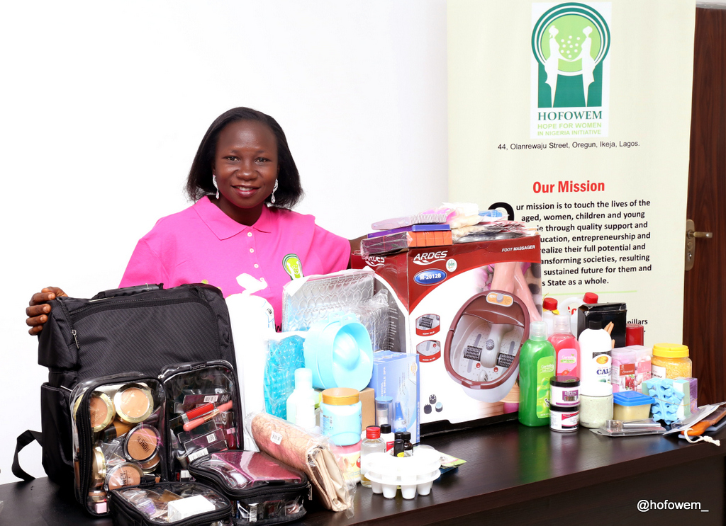 Mrs. Eniola with her work kits.